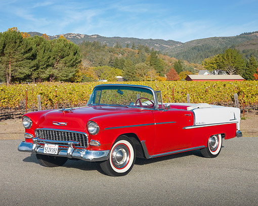 AUT 21 RK2708 01 © Kimball Stock 1955 Chevrolet Bel Air Convertible Red And White 3/4 Front View On Pavement By Vineyard