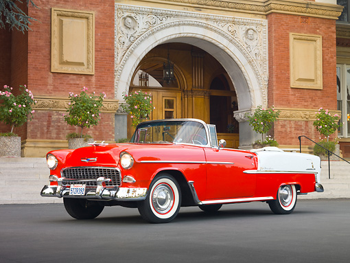 AUT 21 RK2710 01 © Kimball Stock 1955 Chevrolet Bel Air Convertible Red And White 3/4 Front View On Pavement By Building