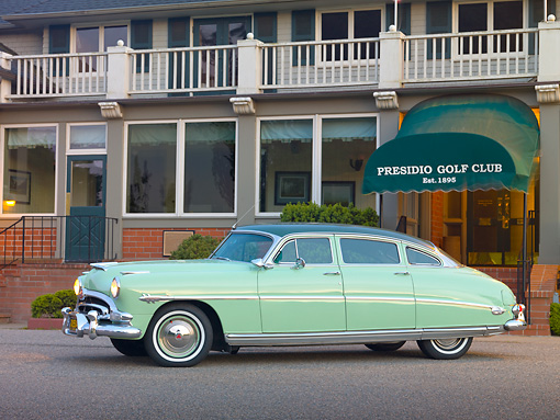 AUT 21 RK2733 01 © Kimball Stock 1953 Hudson Hornet Green 3/4 Side View On Pavement By Golf Club