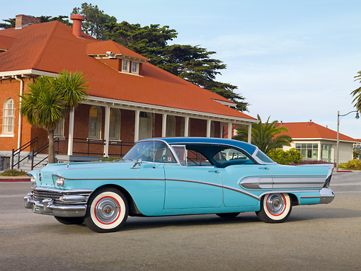 AUT 21 RK2745 01 © Kimball Stock 1958 Buick Special Turquoise Profile View On Pavement By Brick Building