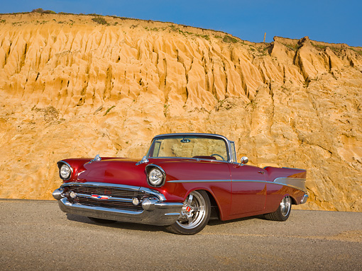 AUT 21 RK2758 01 © Kimball Stock 1957 Chevrolet Bel Air Convertible Red 3/4 Front View On Pavement By Cliffside