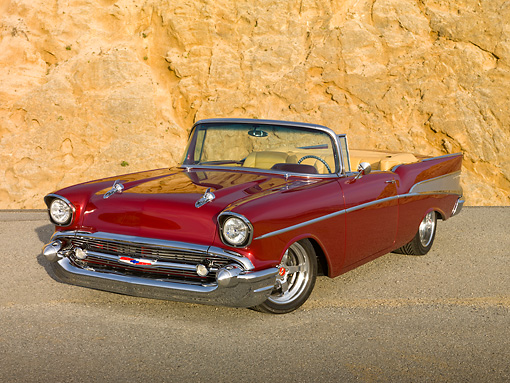 AUT 21 RK2759 01 © Kimball Stock 1957 Chevrolet Bel Air Convertible Red 3/4 Front View On Pavement By Cliffside