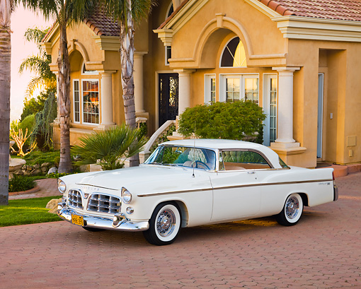 AUT 21 RK2763 01 © Kimball Stock 1956 Chrysler 300B White 3/4 Front View On Brick By House