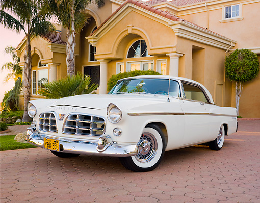 AUT 21 RK2764 01 © Kimball Stock 1956 Chrysler 300B White 3/4 Front View On Brick By House