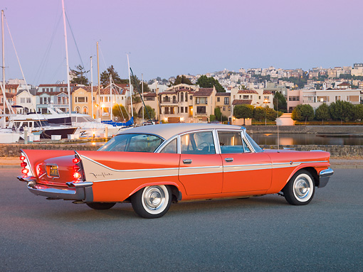 AUT 21 RK2781 01 © Kimball Stock 1958 DeSoto Fireflite Orange 3/4 Rear View On Pavement By Harbor