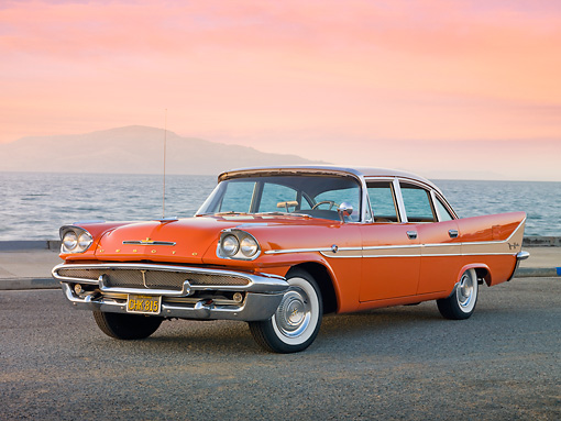 AUT 21 RK2783 01 © Kimball Stock 1958 DeSoto Fireflite Orange 3/4 Front View On Pavement By Bay