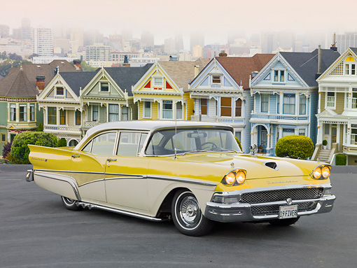 AUT 21 RK2818 01 © Kimball Stock 1958 Ford Fairlane 500 Yellow And White 3/4 Front View On Pavement By Painted Ladies San Francisco