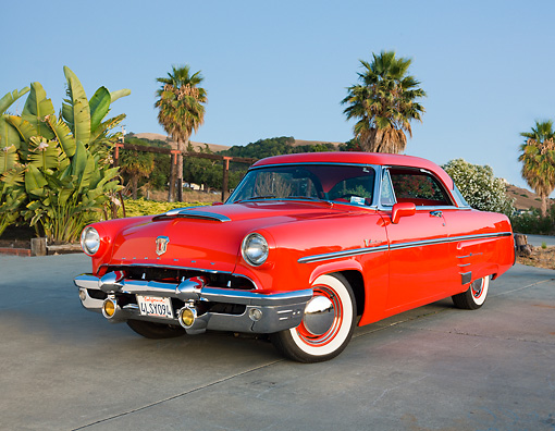 AUT 21 RK2844 01 © Kimball Stock 1953 Mercury Monterey Red 3/4 Front View On Pavement By Palm Trees