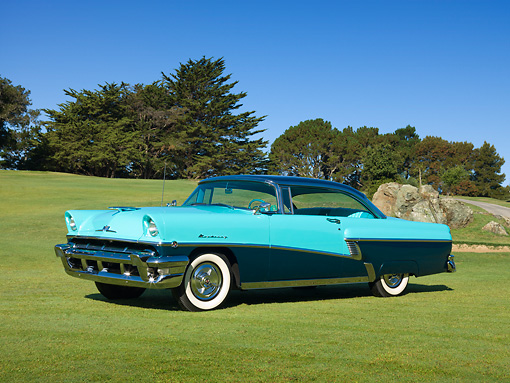 AUT 21 RK2872 01 © Kimball Stock 1956 Mercury Monterey Teal And Green 3/4 Side View On Grass By Trees