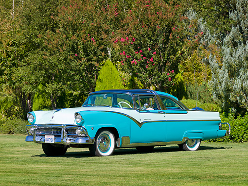 AUT 21 RK2873 01 © Kimball Stock 1955 Ford Crown Victoria Aqua And White 3/4 Front View On Grass By Trees