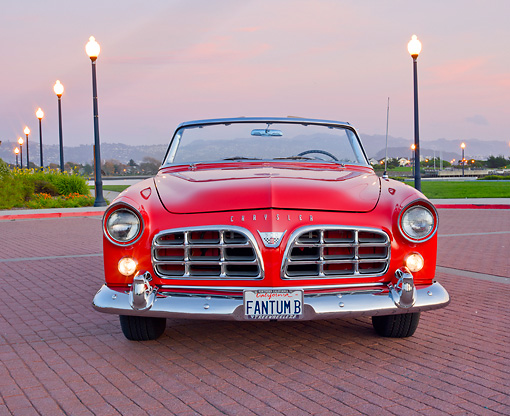 AUT 21 RK2895 01 © Kimball Stock 1956 Chrysler 300B Red Front View On Brick By Lamp Posts At Dusk