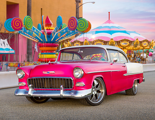 AUT 21 RK2912 01 © Kimball Stock 1955 Chevrolet Bel Air Pink And White 3/4 Front View On Pavement At Carnival