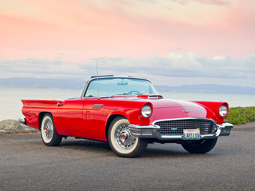 AUT 21 RK2957 01 © Kimball Stock 1957 Ford Thunderbird Convertible Red 3/4 Front View On Pavement By Water At Dusk