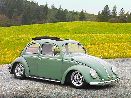 AUT 21 RK2972 01 © Kimball Stock 1956 Volkswagen Bug Agave Green 3/4 Front View On Gravel By Grass And Trees