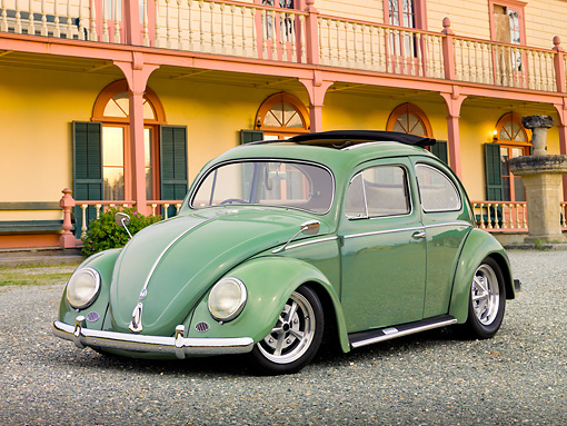 AUT 21 RK2973 01 © Kimball Stock 1956 Volkswagen Bug Agave Green 3/4 Front View On Gravel By Yellow Building