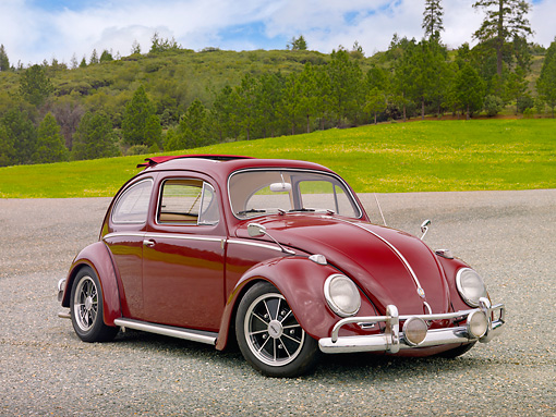 AUT 21 RK2977 01 © Kimball Stock 1959 Volkswagen Beetle Red 3/4 Front View On Gravel By Grass And Trees
