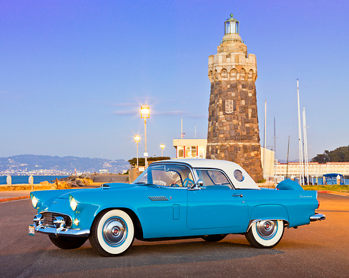 AUT 21 RK2992 01 © Kimball Stock 1956 Ford Thunderbird Blue 3/4 Side View On Pavement By Marina At Night