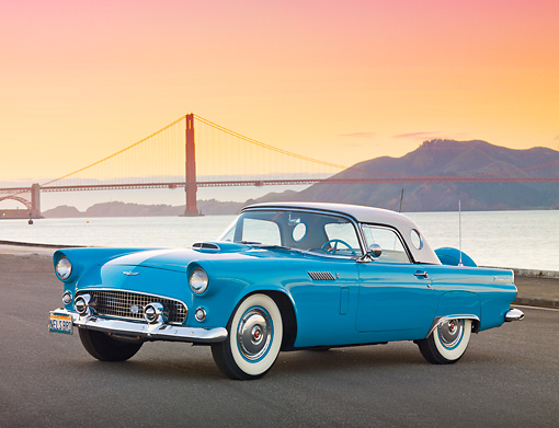 AUT 21 RK2999 01 © Kimball Stock 1956 Ford Thunderbird Blue 3/4 Front View On Pavement By Bay And Golden Gate Bridge