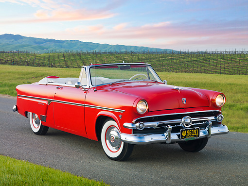 AUT 21 RK3003 01 © Kimball Stock 1954 Ford Sunliner Convertible Red 3/4 Front View On Pavement By Vineyard