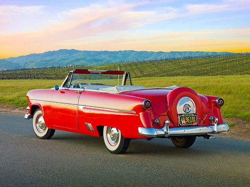 AUT 21 RK3004 01 © Kimball Stock 1954 Ford Sunliner Convertible Red 3/4 Rear View On Pavement By Vineyard