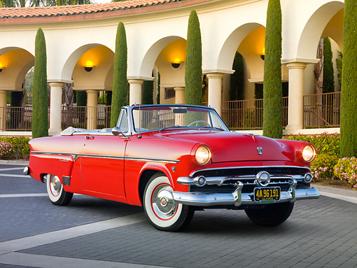 AUT 21 RK3006 01 © Kimball Stock 1954 Ford Sunliner Convertible Red 3/4 Front View On Pavement By Building