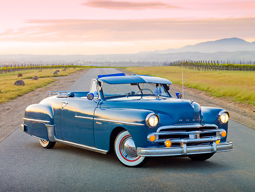 AUT 21 RK3039 01 © Kimball Stock 1950 Dodge Wayfarer Blue 3/4 Front View On Road By Vineyard