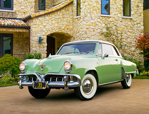 AUT 21 RK3047 01 © Kimball Stock 1952 Studebaker Commander Coupe Green 3/4 Front View On Brick By Stone House