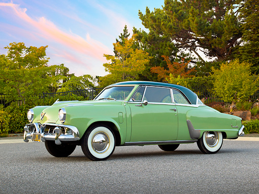 AUT 21 RK3052 01 © Kimball Stock 1952 Studebaker Commander Coupe Green 3/4 Side View On Pavement By Trees