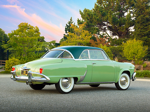 AUT 21 RK3053 01 © Kimball Stock 1952 Studebaker Commander Coupe Green 3/4 Rear View On Pavement By Trees