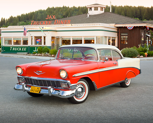 AUT 21 RK3065 01 © Kimball Stock 1956 Chevrolet Bel Air Matador Red And Dune Beige 3/4 Front View On Pavement