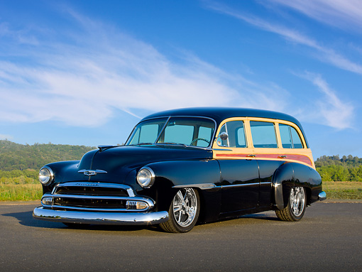 AUT 21 RK3068 01 © Kimball Stock 1951 Chevrolet Tin Woody Black 3/4 Front View On Pavement By Trees