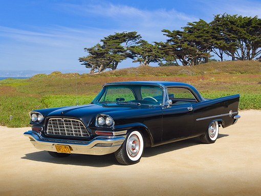 AUT 21 RK3081 01 © Kimball Stock 1957 Chrysler 300C Black 3/4 Front View On Sand By Trees