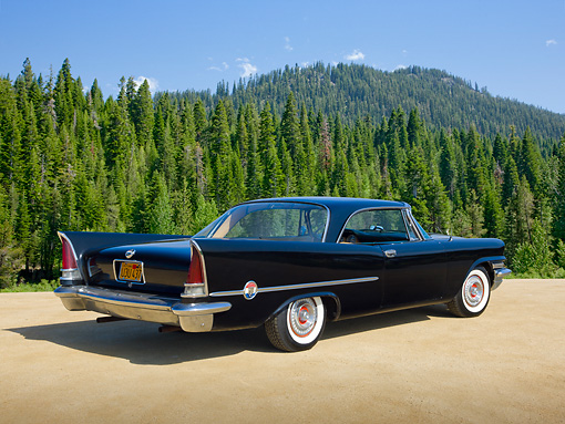 AUT 21 RK3085 01 © Kimball Stock 1957 Chrysler 300C Black 3/4 Rear View On Sand By Pine Trees