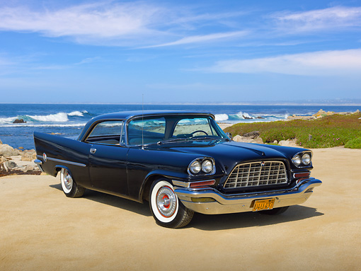 AUT 21 RK3086 01 © Kimball Stock 1957 Chrysler 300C Black 3/4 Front View On Beach