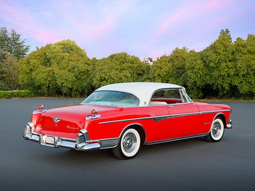 AUT 21 RK3120 01 © Kimball Stock 1955 Chrysler Imperial Newport Coupe Red And White 3/4 Rear View On Pavement