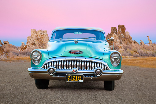 AUT 21 RK3131 01 © Kimball Stock 1953 Buick 76X Skylark Pinehurst Green Front View On Gravel By Red Rock