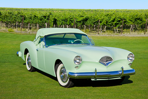 AUT 21 RK3134 01 © Kimball Stock 1954 Kaiser Darrin Pine Tint Green 3/4 Front View On Grass By Vineyard