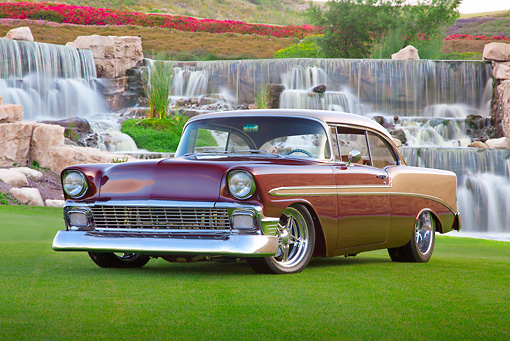 AUT 21 RK3136 01 © Kimball Stock 1956 Chevrolet Bel Air Burgundy And Champagne 3/4 Front View On Grass By Waterfalls