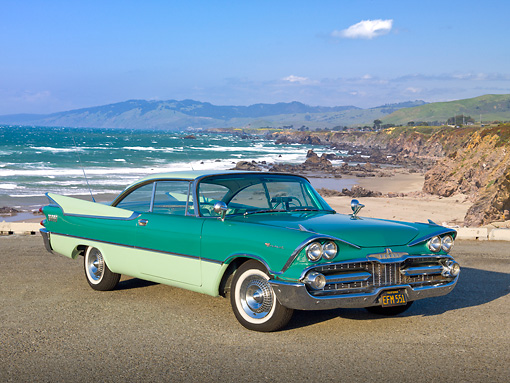 AUT 21 RK3140 01 © Kimball Stock 1959 Dodge Coronet Green 3/4 Front View On Pavement By Beach