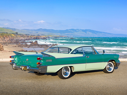 AUT 21 RK3141 01 © Kimball Stock 1959 Dodge Coronet Green 3/4 Rear View On Pavement By Beach