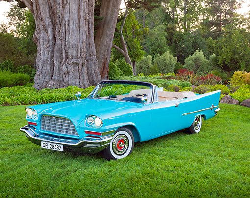 AUT 21 RK3153 01 © Kimball Stock 1957 Chrysler 300C Indian Turquoise 3/4 Front View On Grass By Trees
