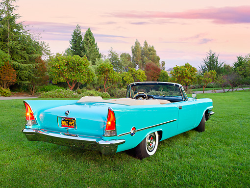 AUT 21 RK3156 01 © Kimball Stock 1957 Chrysler 300C Indian Turquoise 3/4 Rear View On Grass By Trees