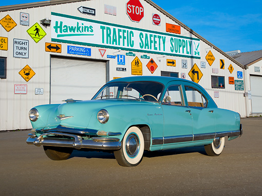 AUT 21 RK3169 01 © Kimball Stock 1952 Kaiser Manhattan Turquoise And Blue 3/4 Front View On Pavement By Traffic Safety Supply Store