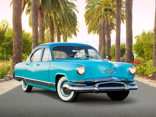 AUT 21 RK3170 01 © Kimball Stock 1952 Kaiser Manhattan Turquoise And Blue 3/4 Front View On Pavement By Palm Trees