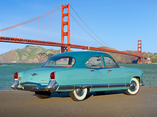 AUT 21 RK3174 01 © Kimball Stock 1952 Kaiser Manhattan Turquoise And Blue 3/4 Rear View On Pavement By Golden Gate Bridge