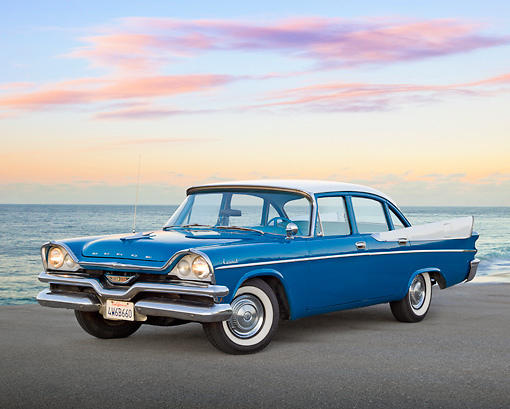 AUT 21 RK3178 01 © Kimball Stock 1957 Dodge Coronet D-501 354 Cid Hemi V8 Hardtop Blue And White 3/4 Front View On Pavement By Ocean