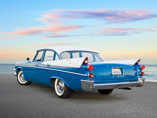 AUT 21 RK3181 01 © Kimball Stock 1957 Dodge Coronet D-501 354 Cid Hemi V8 Hardtop Blue And White 3/4 Rear View On Pavement By Ocean