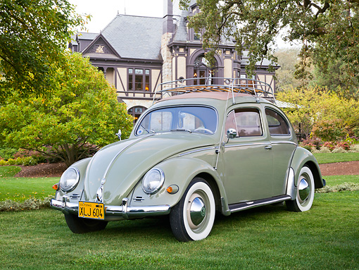 AUT 21 RK3197 01 © Kimball Stock 1956 Volkswagen Beetle Sunroof Sedan Green 3/4 Front View On Grass By House And Trees