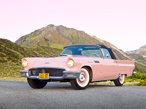 AUT 21 RK3198 01 © Kimball Stock 1957 Ford Thunderbird Dusk Rose 3/4 Front View On Pavement By Hills