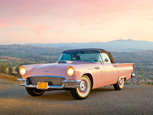 AUT 21 RK3199 01 © Kimball Stock 1957 Ford Thunderbird Dusk Rose 3/4 Front View On Pavement Overlooking City